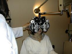 Optometrist determining eyeglasses prescription in the Yarmouth and Dennis, MA, area